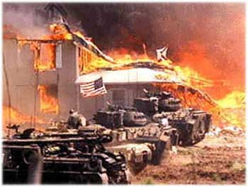 Mount Carmel Center on fire surrounded by U.S. Army tanks